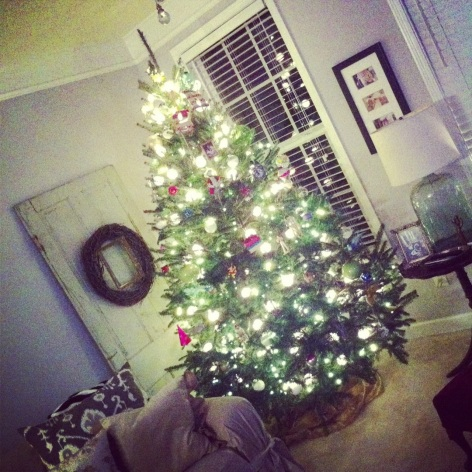 we have our christmas tree up & in a new corner... we're loving this season!